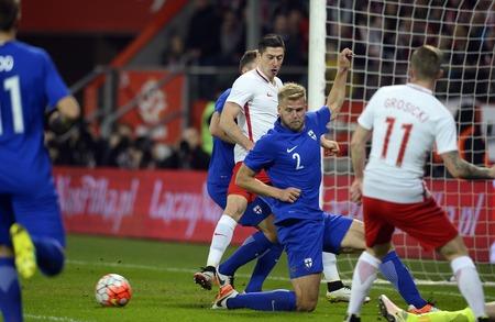 paulus: WROCLAW, POLAND, MARCH 26, 2016: Inernational Friendly football game Poland - Finlando  p Paulus Arajuuri Robert Lewandowski (Lech Poznan)