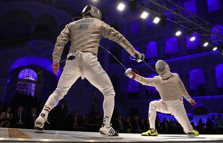 WARSAW, POLAND  FEBRUARY 25, 2017: Sabre de Wolodyjowski, the International Fencing Federation Fencing Cup in mens sword FIA in Warsaw University of Technology Hallo  p international fencing duel in the mens sword Editorial