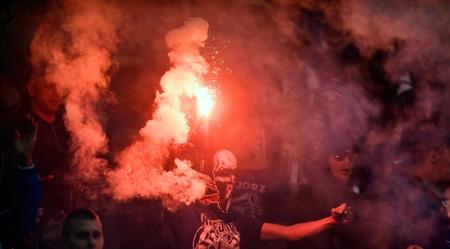 midfielder: WARSAW, POLAND - MAY 02, 2017: Polish Extra League Polish Premier Football League Lech Poznan football supporters during Arka Gdynia game