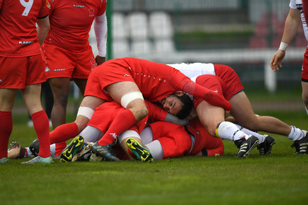 WARSAW, POLAND, APRIL 22, 2017: Inernational rugby game Poland - Switzerland Europe Rugby Cupo  p Poland and Switzerland rugby teams during the game in action Editorial
