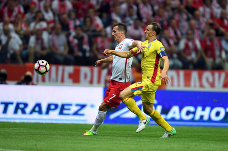 JUNE 10, 2017: 2018 World Cup qualifiers  p Arkadiusz Milik of Poland, Vlad Chiriches of Romania
