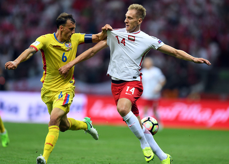WARSAW, POLAND - JUNE 10, 2017: 2018 World Cup Qualifications  p Vlad Chiriches of Romania, Lukasz Teodorczyk of Poland