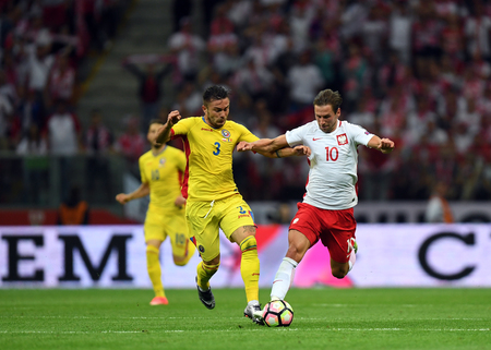 WARSAW, POLAND - JUNE 10, 2017: 2018 World Cup Qualificationso  p Alin Tosca of Romania, Grzegorz Krychowiak of Poland
