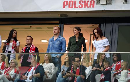 midfielder: JUNE 10, 2017: 2018 World Cup qualifiers  p Kamil Glik of Poland, Anna Lewandowska, Marina Luchenko-Szczesna Editorial