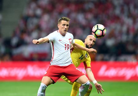 midfielder: JUNE 10, 2017: 2018 World Cup Qualifications  Piotr Zielinski of Poland, Iasmin Latovlevici of Romania
