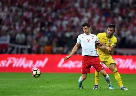 midfielder: JUNE 10, 2017: 2018 World Cup Qualifications  Robert Lewandowski of Poland, Alin Tosca of Romania