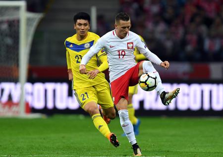 midfielder: 4 SEPTEMBER, 2017 - WARSAW, POLAND: Football World Cup RUSIA 2018 qualification match Poland - Kazakhstano  p Abzal Baysebekov (Kazakhstan) Piotr Zielinski (Poland) Editorial