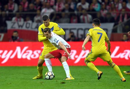midfielder: 4 SEPTEMBER, 2017 - WARSAW, POLAND: Football World Cup Rusia 2018 qualification match Poland - Kazakhstano  p Viktor Dmitrenko (Kazakhstan) Arkadiusz Milik (Poland)