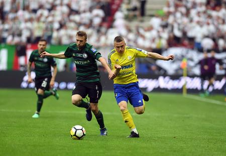 WARSAW, POLAND - MAY 02, 2018: Polish League Cup Final Arka Gdynia vs Legia Warsaw  p: Domagoj Antolic (Legia Warsaw) Michal Nalepa (Arka Gdynia)