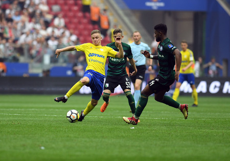 WARSAW, POLAND - MAY 02, 2018: Polish League Cup Final Arka Gdynia vs Legia Warsaw  p: Mateusz Szwoch (Arka Gdynia) William Remy (Legia Warsaw)