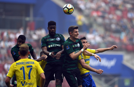 WARSAW, POLAND - MAY 02, 2018: Polish League Cup Final Arka Gdynia vs Legia Warsaw / p: William Remy (Legia Warsaw) Chris Philipps (Legia Warsaw) Dawid Soldecki (Arka Gdynia) Stock Photo - 115120191