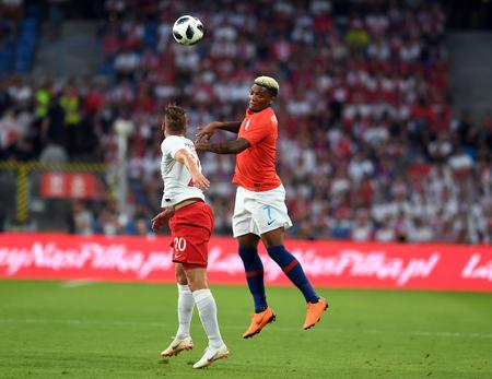 POZNAN, POLAND - MAY 08, 2018: International friendly game between Poland and Chileo  p: Lukasz Piszczek (Poland) Junior Fernandes (Chile)