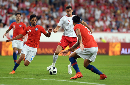 POZNAN, POLAND - MAY 08, 2018: International friendly game between Poland and Chileo  p: Robert Lewandowski (Poland) Jimmy Martinez (Chile)