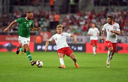 WROCLAW, POLAND - SEPTEMBER 11, 2018: International friendly game between Poland and Republic of Ireland  p: David Meyler (Republic of Ireland) Jakub Blaszczykowski (Poland)