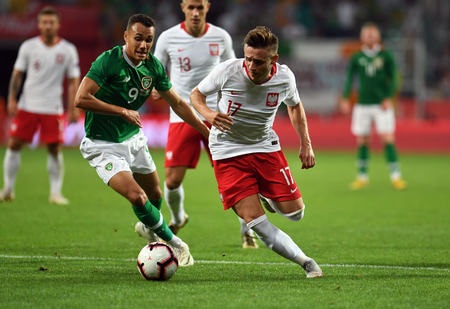 WROCLAW, POLAND - SEPTEMBER 11, 2018: International friendly game between Poland and Republic of Ireland  p: Graham Burke (Republic of Ireland) Damian Kedzior (Poland)