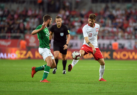 WROCLAW, POLAND - SEPTEMBER 11, 2018: International friendly game between Poland and the Republic of Ireland / p: Conor Hourihane (Republic of Ireland) Mateusz Klich (Poland) Stock Photo - 115120334