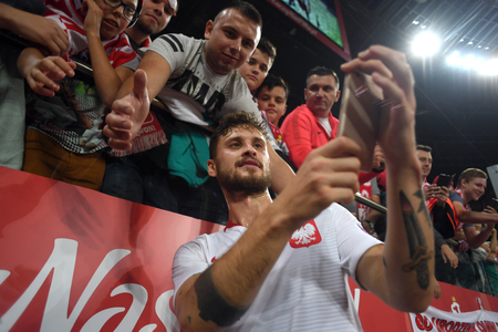 WROCLAW, POLAND - SEPTEMBER 11, 2018: International friendly game between Poland and Republic of Ireland  p: Mateusz Klich (Poland) with fans Editorial