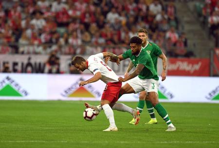 WROCLAW, POLAND - SEPTEMBER 11, 2018: International friendly game between Poland and Republic of Ireland  p: Karol Linetty (Poland) Cyrus Christie (Republic of Ireland)