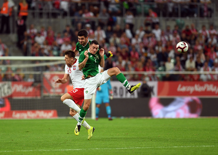 WROCLAW, POLAND - SEPTEMBER 11, 2018: International friendly game between Poland and the Republic of Ireland  p: Krzysztof Piatek (Poland) Shaun Williams (Republic of Ireland)