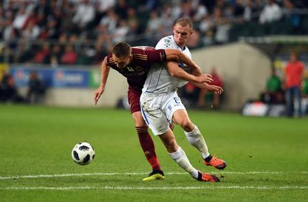 16 OCTOBER 2018 - WARSAW, POLAND: Polish Extra League LOTTO Ekstraklasa football match Legia Warszawa - Lech Poznano / p Artur Jedrzejczyk (Legia Warszawa) Rafal Tomczyk (Lech Poznan)