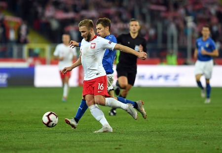CHORZOW, POLAND - OCTOBER 14, 2018: UEFA Nations League Poland and Italyo  p: Jakub Blaszczykowski (Poland) Nicolo Barella (Italy)