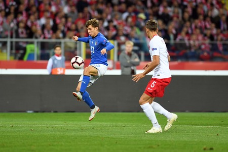 CHORZOW, POLAND - OCTOBER 14, 2018: UEFA Nations League Poland and Italyo  p: Nicolo Barella (Italy) Jan Bednarek (Poland)