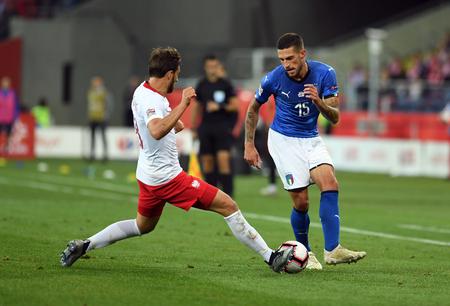 CHORZOW, POLAND - OCTOBER 14, 2018: UEFA Nations League Poland and Italy  p: Bartosz Bereszynski (Poland) Cristiano Biraghi (Italy)