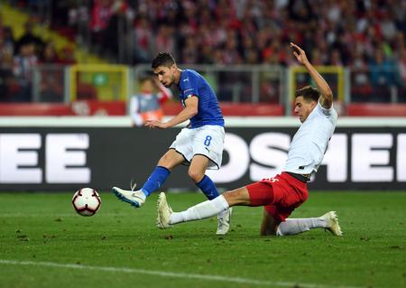 CHORZOW, POLAND - OCTOBER 14, 2018: UEFA Nations League Poland and Italy  p: Jorginho (Italy) Jan Bednarek (Poland)