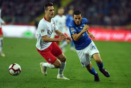 CHORZOW, POLAND - OCTOBER 14, 2018: UEFA Nations League Poland and Italy  p: Jan Bednarek (Poland) Alessandro Florezi (Italy) Editorial