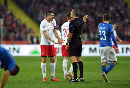 CHORZOW, POLAND - OCTOBER 14, 2018: UEFA Nations League Poland and Italy  p: Robert Lewandowski (Poland) argues with refree Editorial