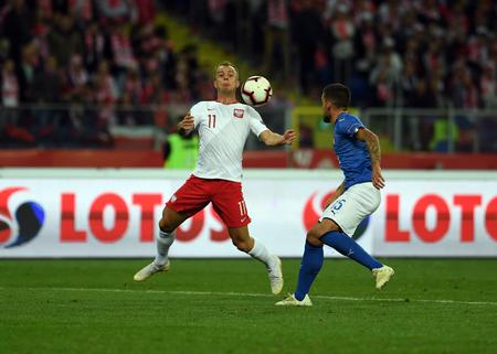 CHORZOW, POLAND - OCTOBER 14, 2018: UEFA Nations League Poland and Italy  p: Kamil Grosicki (Poland) 0 Cristiano Biraghi (Italy)