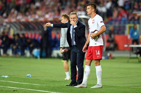 CHORZOW, POLAND - OCTOBER 14, 2018: UEFA Nations League Poland and Italy  p: Jerzy Brzeczek Coach (Poland) Arkadiusz Reca (Poland)