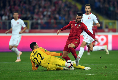 CHORZOW, POLAND - OCTOBER 11, 2018: UEFA Nations League Poland and Portugal  p: Rafa Silva (Portugal) Lukasz Fabianski (Poland)