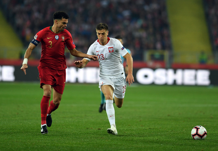 CHORZOW, POLAND - OCTOBER 11, 2018: UEFA Nations League Poland and Portugal  p: Pepe (Portugal) Krzysztof Piatek (Poland) Editorial