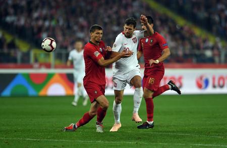 CHORZOW, POLAND - OCTOBER 11, 2018: UEFA Nations League Poland and Portugal  p: Grzegorz Krychowiak (Poland) Ruben Neves (Portugal)