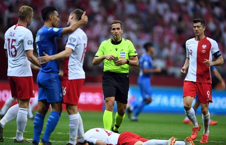 Warsaw, Poland, June 10, 2019: EURO 2020 qualifing round, group stage, Poland wins 4:0 with Izarel on PGE Narodowy. Tobias Stieler (refree) gives yellow card