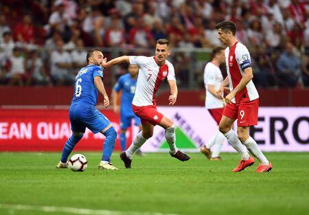 Warsaw, Poland, June 10, 2019: EURO 2020 qualifing round, group stage, Poland wins 4: 0 with Izarel on PGE Narodowy. Bibras Natcho (Israel) Arkadiusz Milik (Poland)