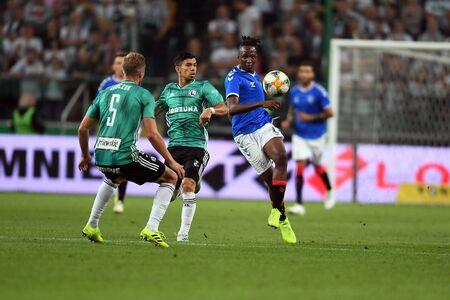 Warsaw, Poland, August 22, 2019: UEFA Europa League qualification round Legia Warsaw - Glasgow Rangers FC: Andre Martins (Legia Warszawa) Joseph Ayodele-Aribo (Rangers FC) in action