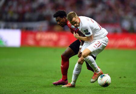 Warsaw, Poland, September 9, 2019: EURO 2020 qualifing round, group stage, Poland draws 0: 0 with Austrial on PGE Narodowy.David Alaba (Austria) Tomasz Kedziora (Poland) Редакционное