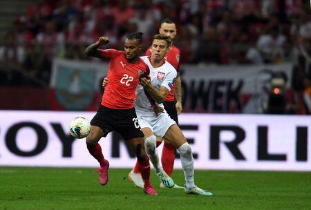 Warsaw, Poland, September 9, 2019: EURO 2020 qualifing round, group stage, Poland draws 0: 0 with Austrial on PGE Narodowy. Valentino Lazaro (Austria) Jan Bednarek (Poland)