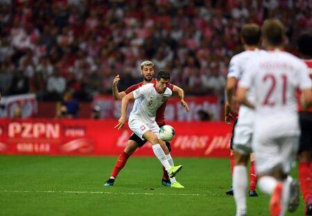 Warsaw, Poland, September 9, 2019: EURO 2020 qualifing round, group stage, Poland draws 0: 0 with Austrial on PGE Narodowy.Aleksandar Dragovic (Austria) Robert Lewandowski (Poland) Редакционное