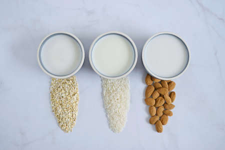 Different vegan milk: almond milk, rise milk and oat milk