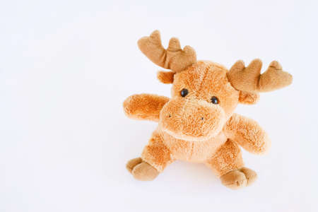 Children Toy collection, Soft brown deer on a white background. soft christmas toy brown deer.