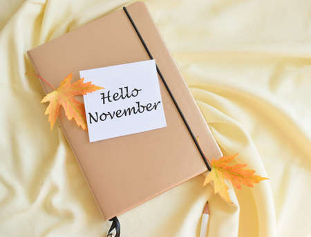 Hello October on Paper Note on texture background. Stock Photo