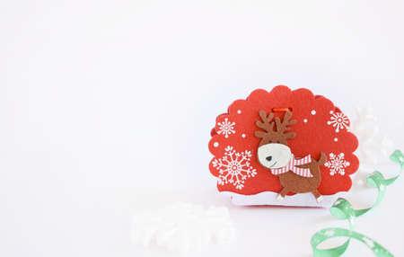Attractive felt Christmas basket on white background.
