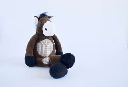 Children Toy collection, Soft brown horse on a white background. Copy space.