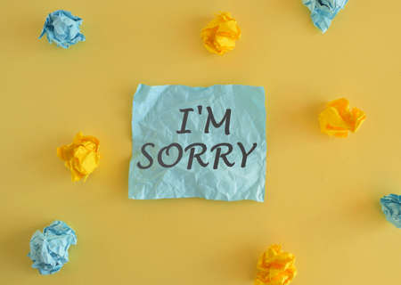 Business photo text To ask for forgiveness to someone yo.u unintensionaly hurt Conceptual hand writing showing I M Sorry. Colored sticky note and crumpled papers above yellow background