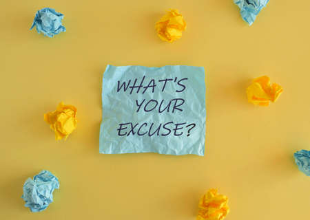 Handwriting text What s is Your Excuse question. Concept meaning Explanations for not doing something. Colored sticky note above yellow background. Stockfoto
