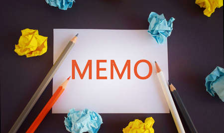 MEMO word written ower white paper, with space. Business memo concept.