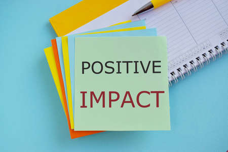 Concept of Positive Impact text written on sticker note